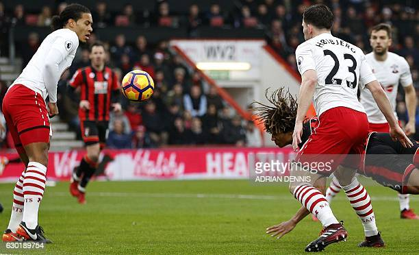 Bournemouth's Dutch defender Nathan Ake dives to head the ball and score his team's first goal past Southampton's Dutch defender Virgil van Dijk and...
