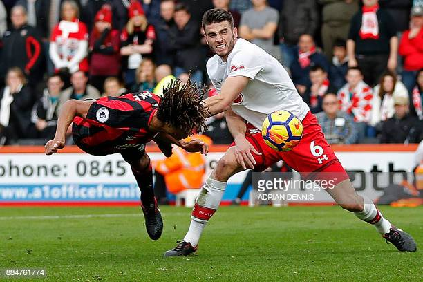 Bournemouth's Dutch defender Nathan Ake fails with this headed attempt as Southampton's Dutch defender Wesley Hoedt defends during the English...