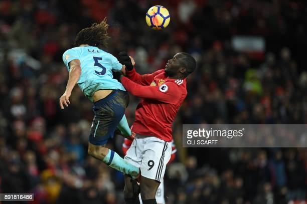 Bournemouth's Dutch defender Nathan Ake heads the ball by Manchester United's Belgian striker Romelu Lukaku during the English Premier League...