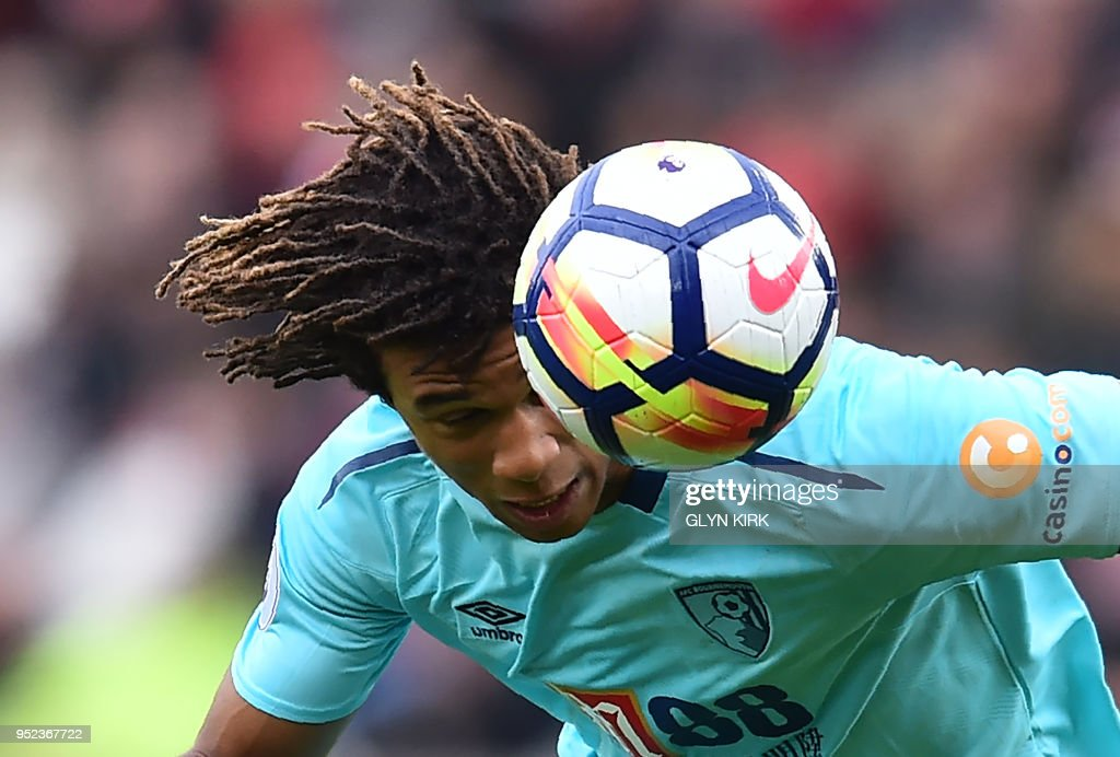 Bournemouth's Dutch defender Nathan Ake heads the ball during the English Premier League football match between Southampton and Bournemouth at St Mary's Stadium in Southampton, southern England on April 28, 2018. (Photo by Glyn KIRK / AFP) / RESTRICTED TO EDITORIAL USE. No use with unauthorized audio, video, data, fixture lists, club/league logos or 'live' services. Online in-match use limited to 75 images, no video emulation. No use in betting, games or single club/league/player publications. /