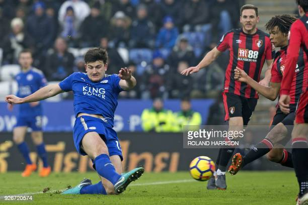 Bournemouth's Dutch defender Nathan Ake manages to block Leicester City's English defender Harry Maguire's shot during the English Premier League...