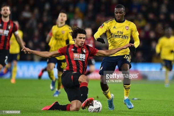 Bournemouth's Dutch defender Nathan Ake vies with Arsenal's English striker Eddie Nketiah during the English FA Cup fourth round football match...