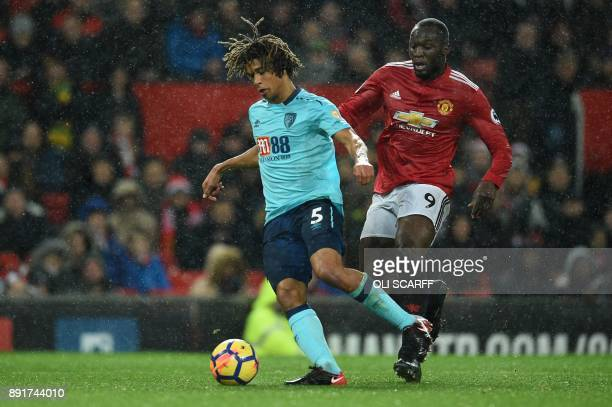 Bournemouth's Dutch defender Nathan Ake vies with Manchester United's Belgian striker Romelu Lukaku during the English Premier League football match...