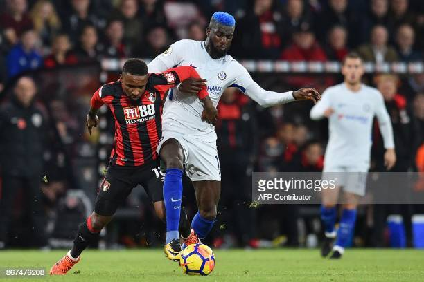 Bournemouth's Englilsh striker Jermain Defoe vies with Chelsea's French midfielder Tiemoue Bakayoko during the English Premier League football match...