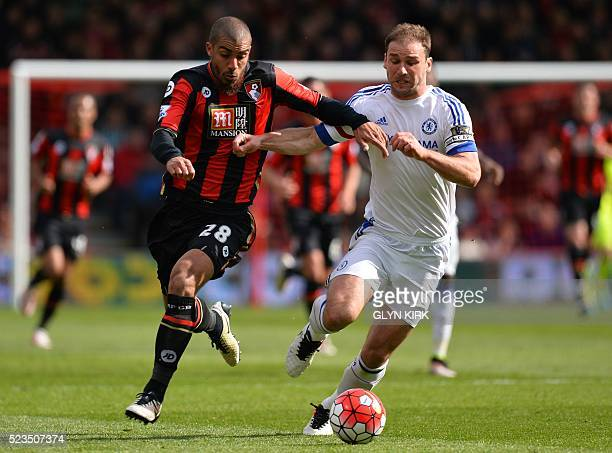 Bournemouth's English born Jamaican striker Lewis Grabban vies with Chelsea's Serbian defender Branislav Ivanovic during the English Premier League...