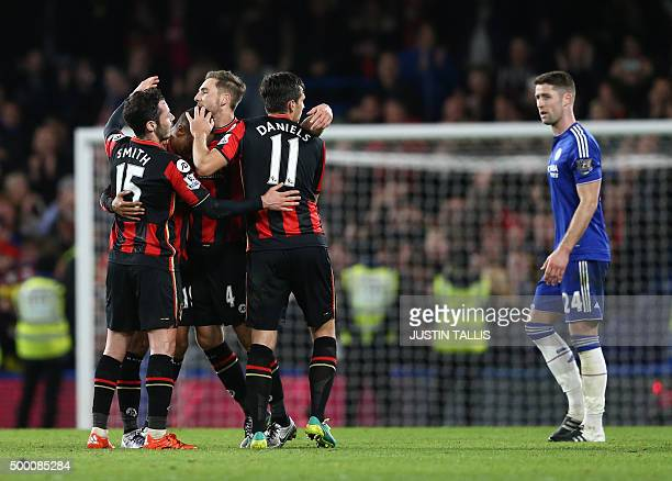 Bournemouth's English defender Adam Smith and Bournemouth's English midfielder Charlie Daniels celebrate with teammates after winning the English...