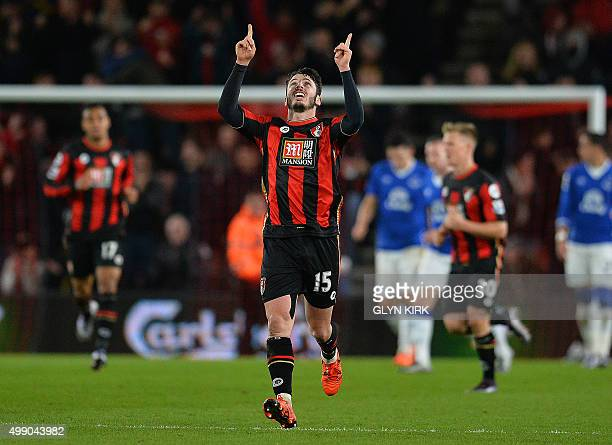 Bournemouth's English defender Adam Smith celebrates scoring his team's first goal during the English Premier League football match between...