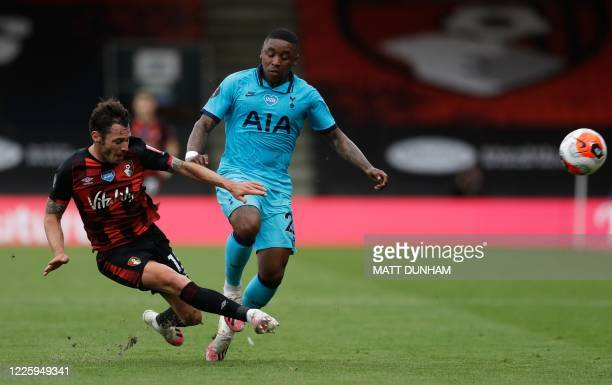 Bournemouth's English defender Adam Smith vies for the ball with Tottenham Hotspur's Dutch midfielder Steven Bergwijn during the English Premier...
