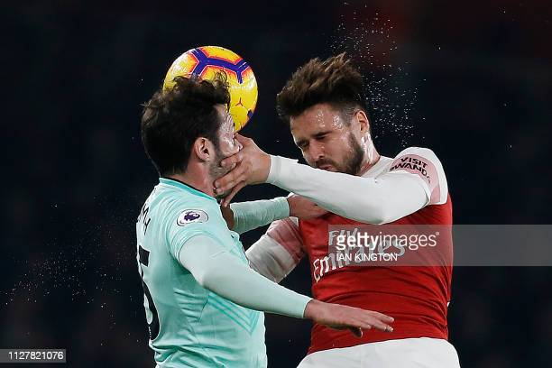 Bournemouth's English defender Adam Smith vies to header the ball with Arsenal's English defender Carl Jenkinson during the English Premier League...