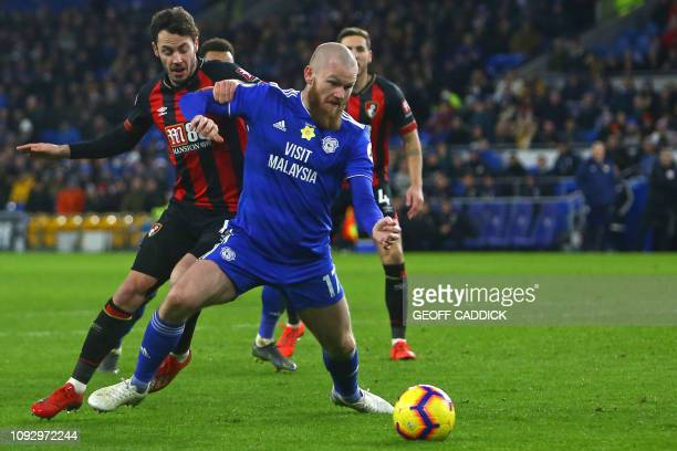 Bournemouth's English defender Adam Smith vies with Cardiff City's Icelandic midfielder Aron Gunnarsson during the English Premier League football...