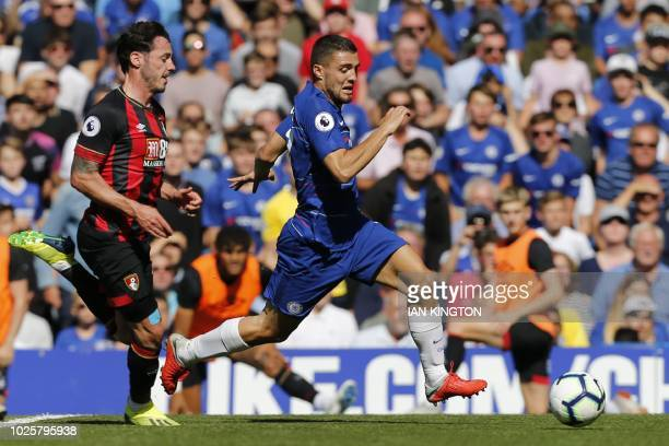 Bournemouth's English defender Adam Smith vies with Chelsea's Croatian midfielder Mateo Kovacic during the English Premier League football match...