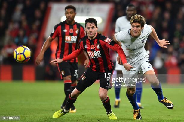 Bournemouth's English defender Adam Smith vies with Chelsea's Spanish defender Marcos Alonso during the English Premier League football match between...