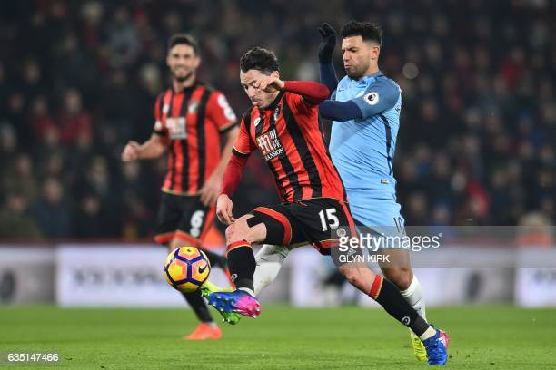 Bournemouth's English defender Adam Smith vies with Manchester City's Argentinian striker Sergio Aguero during the English Premier League football...