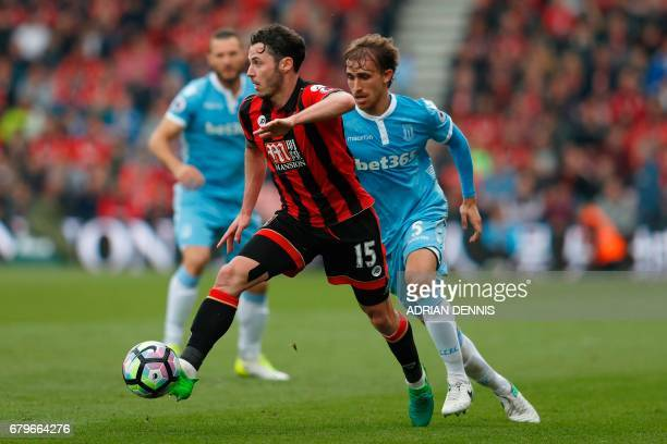 Bournemouth's English defender Adam Smith vies with Stoke City's Spanish defender Marc Muniesa during the English Premier League football match...