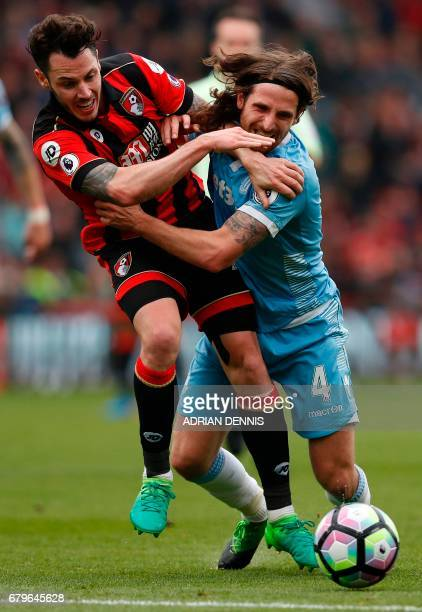 Bournemouth's English defender Adam Smith vies with Stoke City's Welsh midfielder Joe Allen during the English Premier League football match between...