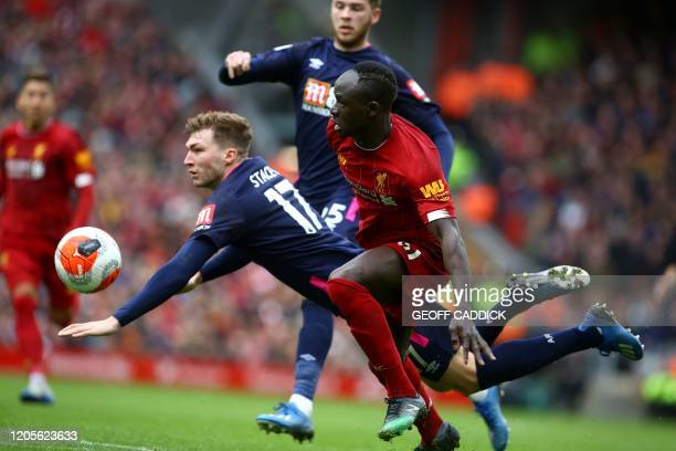 Bournemouth's English defender Jack Stacey is tckled by Liverpool's Senegalese striker Sadio Mane during the English Premier League football match...