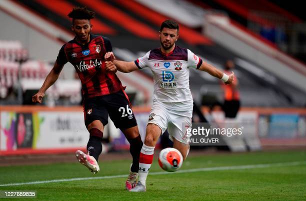 Bournemouth's English defender Lloyd Kelly fights for the ball with Southampton's Irish striker Shane Long during the English Premier League football...
