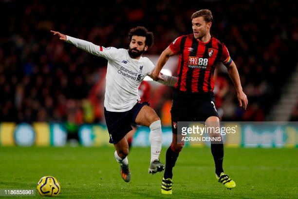 Bournemouth's English defender Simon Francis challenges Liverpool's Egyptian midfielder Mohamed Salah during the English Premier League football...