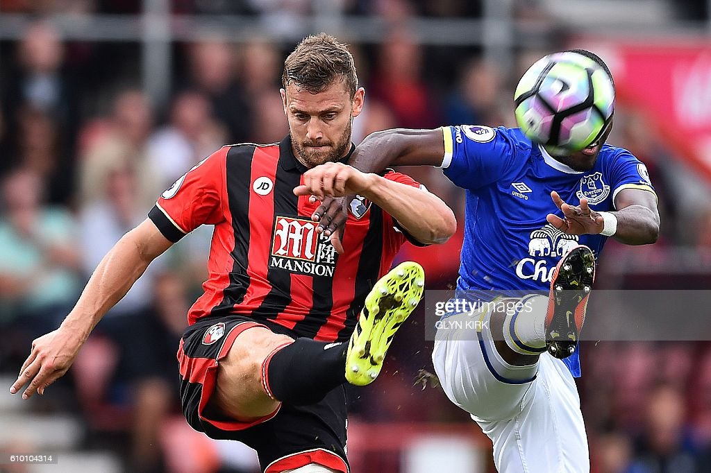 Bournemouth's English defender Simon Francis (L) clears the ball from the path of Tottenham Hotspur's Belgian midfielder Mousa Dembele during the English Premier League football match between Bournemouth and Everton at the Vitality Stadium in Bournemouth, southern England on September 24, 2016. / AFP / GLYN KIRK / RESTRICTED TO EDITORIAL USE. No use with unauthorized audio, video, data, fixture lists, club/league logos or 'live' services. Online in-match use limited to 75 images, no video emulation. No use in betting, games or single club/league/player publications. /