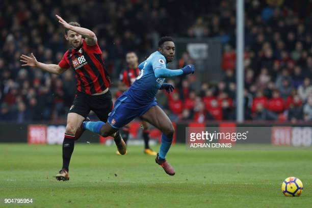 Bournemouth's English defender Simon Francis fouls Arsenal's English striker Danny Welbeck to gain a yellow card during the English Premier League...