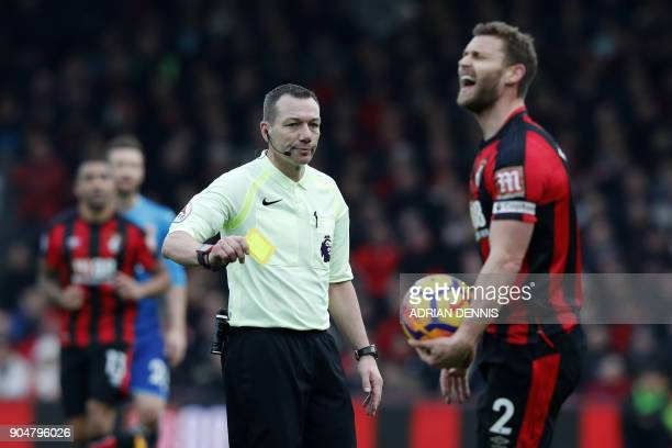 Bournemouth's English defender Simon Francis gets a yellow card after fouling Arsenal's English striker Danny Welbeck during the English Premier...