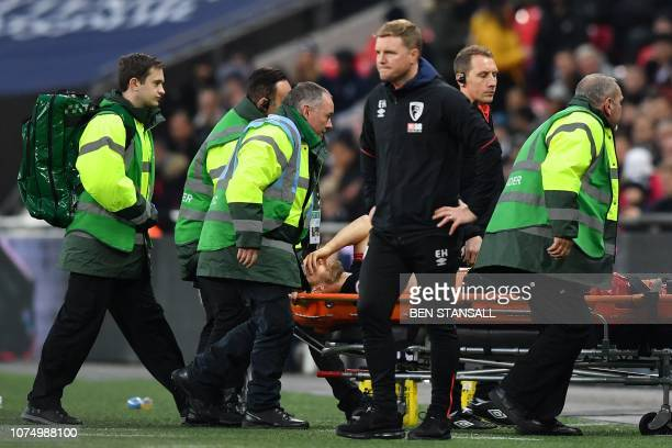 Bournemouth's English defender Simon Francis is taken off the pitch on a stretcher during the English Premier League football match between Tottenham...