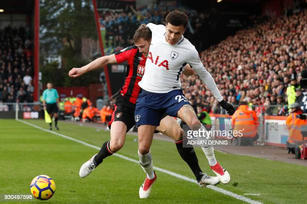 TOPSHOT Bournemouth's English defender Simon Francis pushes Tottenham Hotspur's English midfielder Dele Alli off the ball during the English Premier...