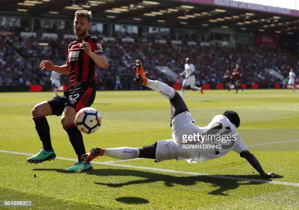 Bournemouth's English defender Simon Francis vies with Swansea City's English midfielder Nathan Dyer during the English Premier League football match...