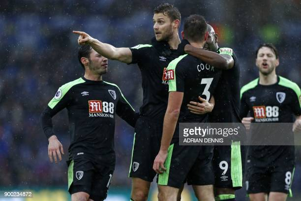 Bournemouth's English defender Steve Cook celebrates with teammates after scoring their first goal during the English Premier League football match...