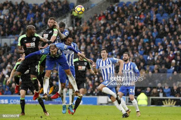 Bournemouth's English defender Steve Cook climbs highest to head home their first goal during the English Premier League football match between...