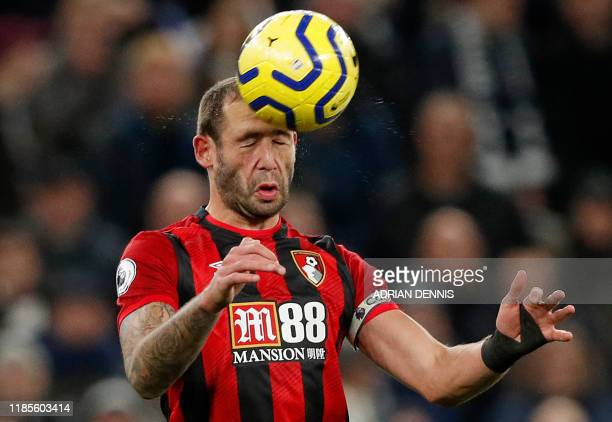 Bournemouth's English defender Steve Cook headers the ball during the English Premier League football match between Tottenham Hotspur and Bournemouth...
