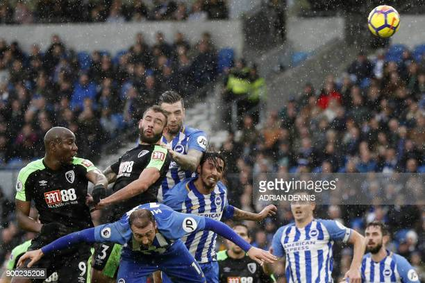 Bournemouth's English defender Steve Cook heads home their first goal during the English Premier League football match between Brighton and Hove...