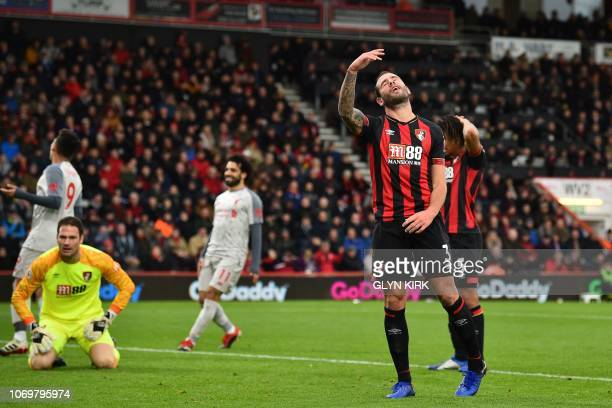 Bournemouth's English defender Steve Cook reacts after he deflects a cross into his own net during the English Premier League football match between...