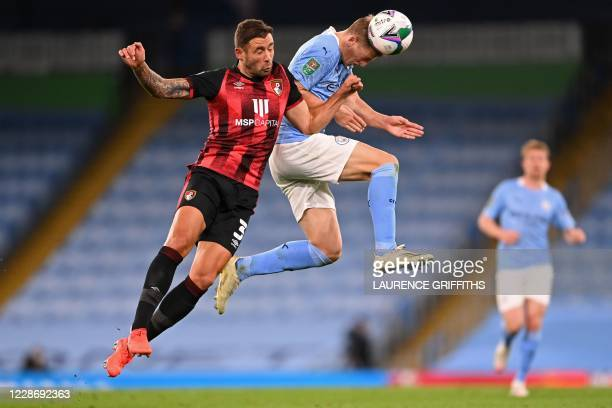 Bournemouth's English defender Steve Cook vies with Manchester City's English midfielder Liam Delap during the English League Cup third round...