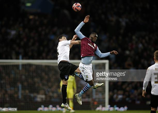 Bournemouth's English defender Tommy Elphick vies with Aston Villa's Zaireborn Belgian striker Christian Benteke during the FA Cup fourth round...
