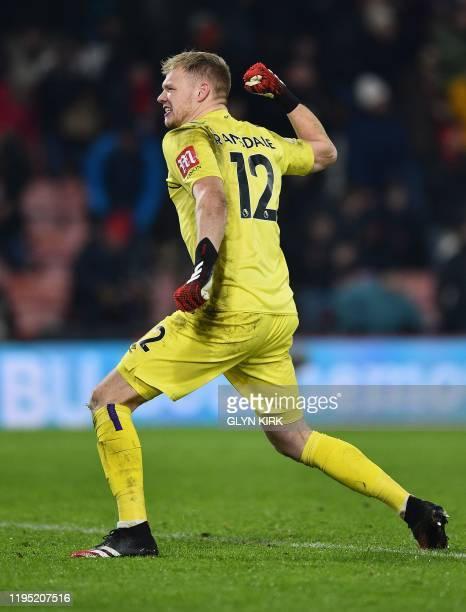 Bournemouth's English goalkeeper Aaron Ramsdale celebrates at the final whistle during the English Premier League football match between Bournemouth...