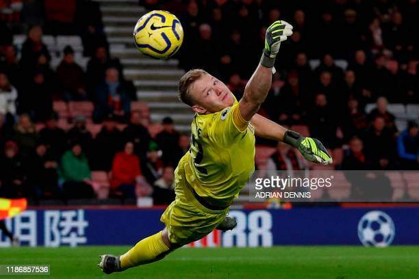 Bournemouth's English goalkeeper Aaron Ramsdale dives as a free kick goes wide of the post during the English Premier League football match between...