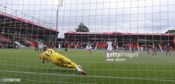 Bournemouth's English goalkeeper Aaron Ramsdale makes a save on a penalty of Southampton's English striker Danny Ings during the English Premier...