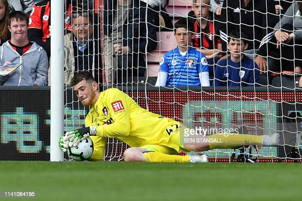 Bournemouth's English goalkeeper Mark Travers dives to make a save during the English Premier League football match between Bournemouth and Tottenham...