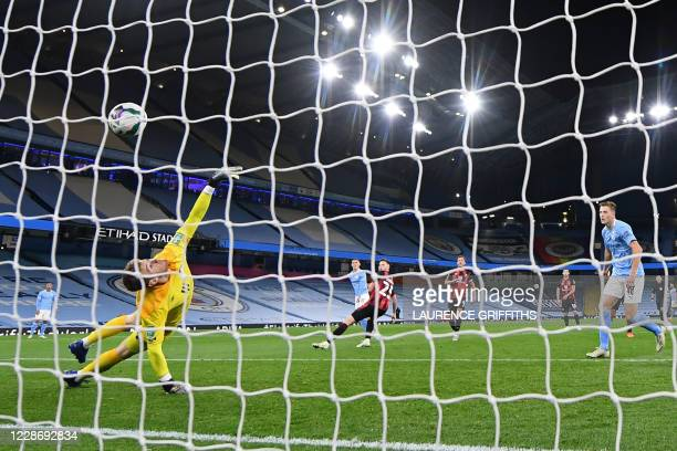 Bournemouth's English goalkeeper Mark Travers is unable to prevent a shot from Manchester City's English midfielder Phil Foden making it 21 during...