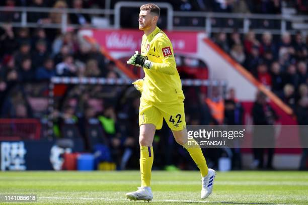Bournemouth's English goalkeeper Mark Travers runs on the pitch during the English Premier League football match between Bournemouth and Tottenham...