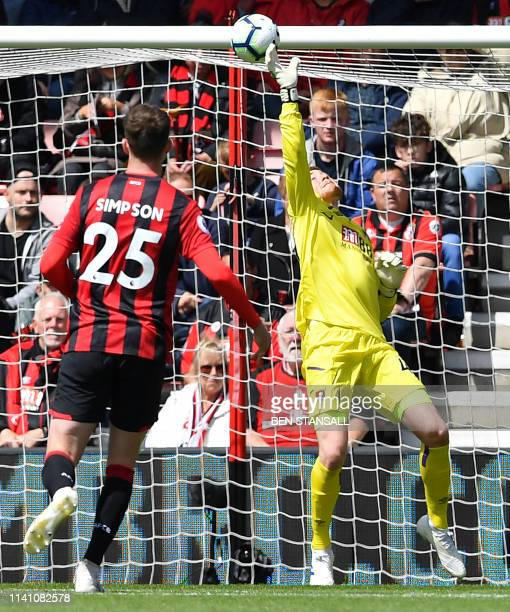 Bournemouth's English goalkeeper Mark Travers saves a shot from Tottenham Hotspur's Brazilian midfielder Lucas Moura during the English Premier...