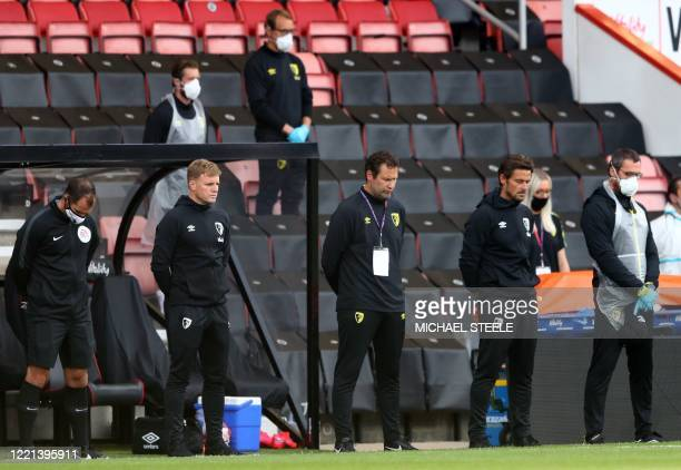 Bournemouth's English manager Eddie Howe stands for a minute of silence for those affected by Covid-19 ahead of the English Premier League football...