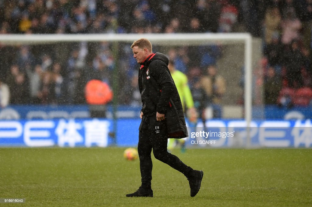 Bournemouth's English manager Eddie Howe walks after the English Premier League football match between Huddersfield Town and Bournemouth at the John Smith's stadium in Huddersfield, northern England on February 11, 2018. / AFP PHOTO / Oli SCARFF / RESTRICTED TO EDITORIAL USE. No use with unauthorized audio, video, data, fixture lists, club/league logos or 'live' services. Online in-match use limited to 75 images, no video emulation. No use in betting, games or single club/league/player publications. /