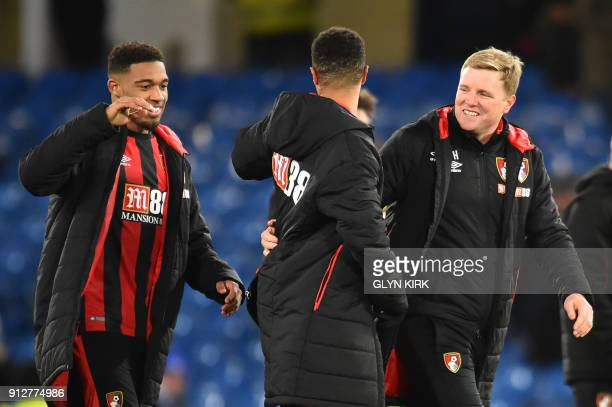 Bournemouth's English manager Eddie Howe walks off with Bournemouth's English midfielder Junior Stanislas after the final whistle during the English...