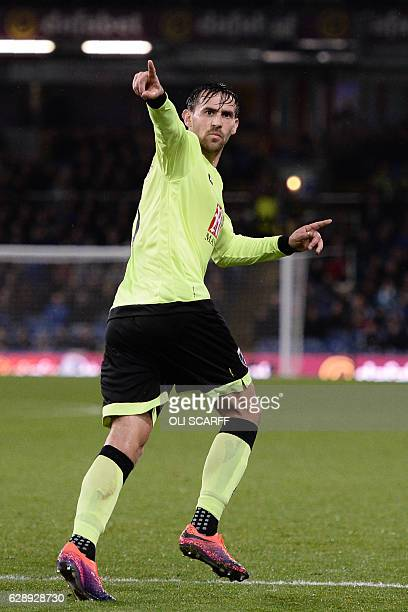 Bournemouth's English midfielder Charlie Daniels celebrates after scoring their second goal during the English Premier League football match between...
