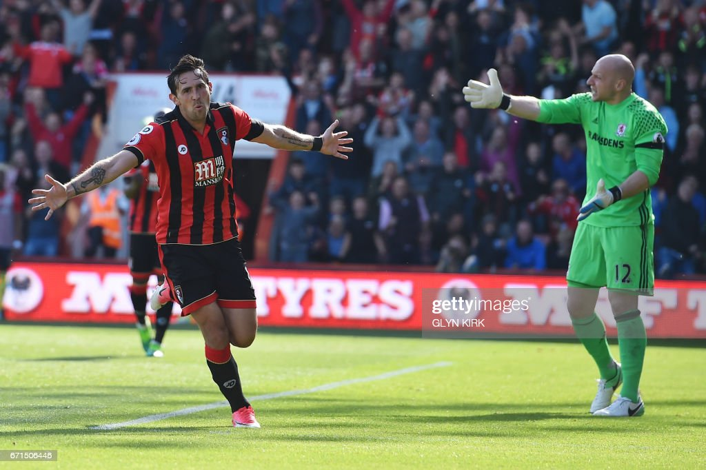 Bournemouth's English midfielder Charlie Daniels (L) celebrates after scoring their fourth goal during the English Premier League football match between Bournemouth and Middlesbrough at the Vitality Stadium in Bournemouth, southern England on April 22, 2017. / AFP PHOTO / Glyn KIRK / RESTRICTED TO EDITORIAL USE. No use with unauthorized audio, video, data, fixture lists, club/league logos or 'live' services. Online in-match use limited to 75 images, no video emulation. No use in betting, games or single club/league/player publications. /