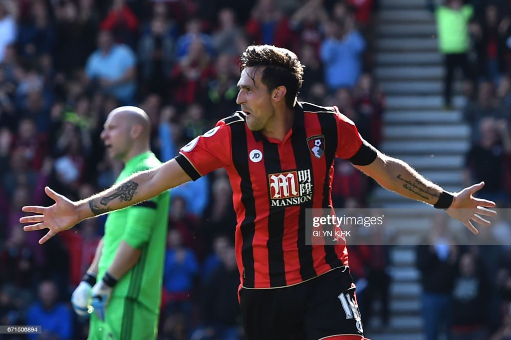Bournemouth's English midfielder Charlie Daniels celebrates after scoring their fourth goal during the English Premier League football match between Bournemouth and Middlesbrough at the Vitality Stadium in Bournemouth, southern England on April 22, 2017. / AFP PHOTO / Glyn KIRK / RESTRICTED TO EDITORIAL USE. No use with unauthorized audio, video, data, fixture lists, club/league logos or 'live' services. Online in-match use limited to 75 images, no video emulation. No use in betting, games or single club/league/player publications. /