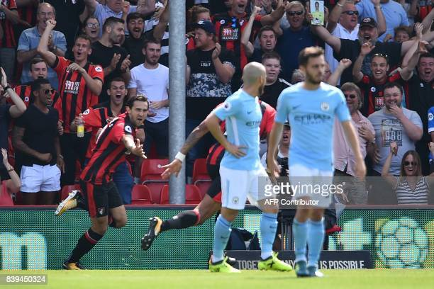 Bournemouth's English midfielder Charlie Daniels celebrates after scoring the opening goal of the English Premier League football match between...