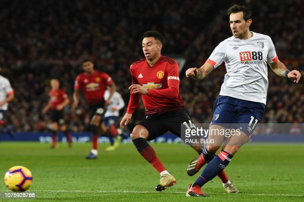 Bournemouth's English midfielder Charlie Daniels passes the ball during the English Premier League football match between Manchester United and...